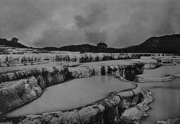 A black and white photo of the famous Pink and White Terraces before they were covered during the eruption of Mount Tarawera