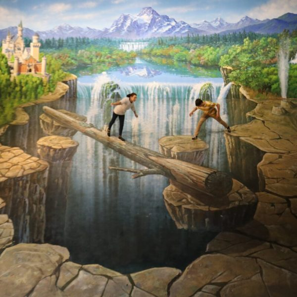 People posing over 3d art painting